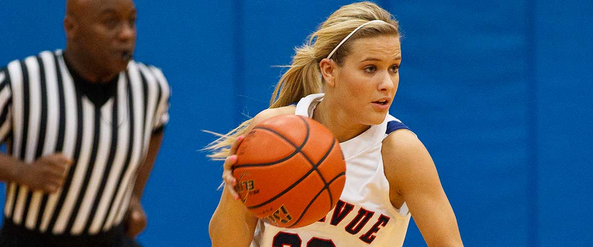 Image of female student playing basketball