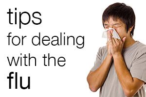 Ad: Tips for Dealing with the Flu. Image of man blowing nose. Links to Flu Readiness website.