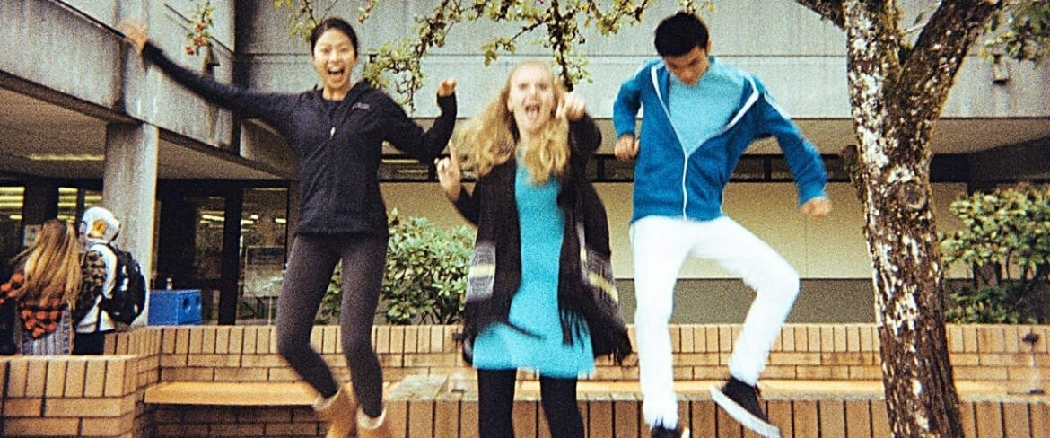 Three Bellevue College students jumping for a photo