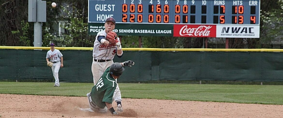 A BC baseball infielder throws the ball from second base toward first vs. Shoreline
