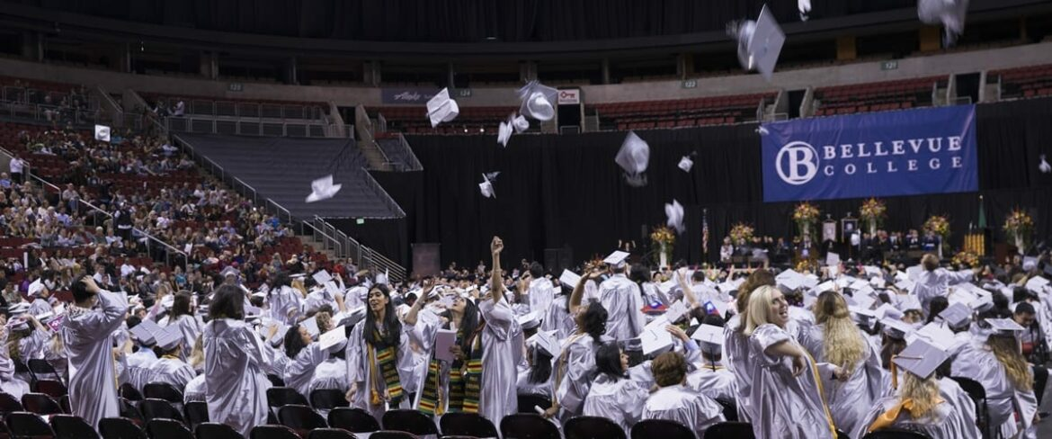 BC Graduates throw their caps into the air during the 2016 ceremony at Key Arena