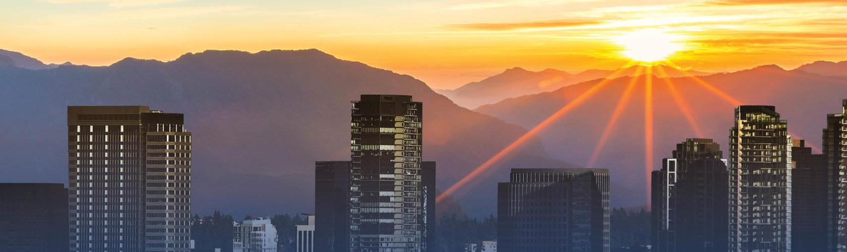 sun rising over Seattle skyline