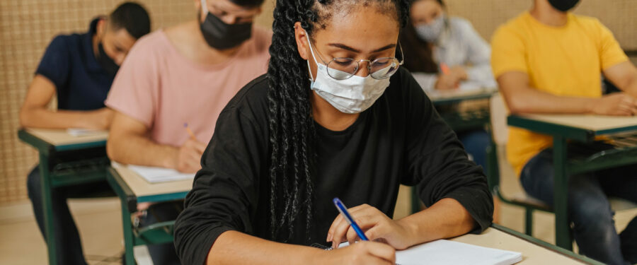 Student in classroom with mask on