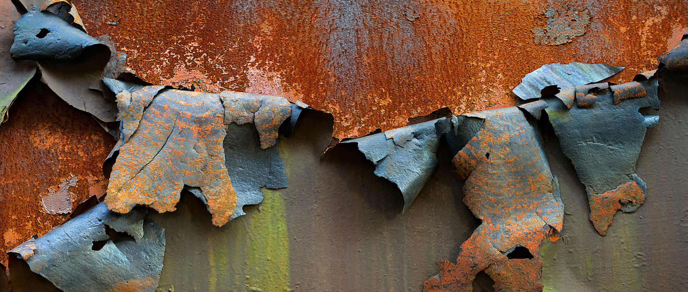 picture by Alyssa Eve Csuk of rusted steel and peeling paint