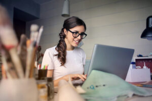 Woman using her laptop representing online learning