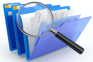 Magnifying Glass held over file folders