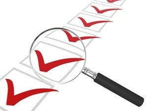 check marks in boxes with magnifying glass