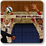 BC volleyball players go up for a block at the net