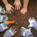 Circle of hands in the dirt