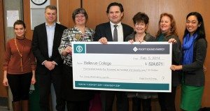 PSE holding big check to Bellevue College for lighting retrofits