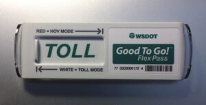 The new Flex Pass transponder, for use on the new I-405 Express Toll Lanes this fall, lets drivers switch between the red HOV position, for toll-free travel with three or more persons at peak times; and the green TOLL position, for one- or two-person vehicles to pay to enter the new lanes