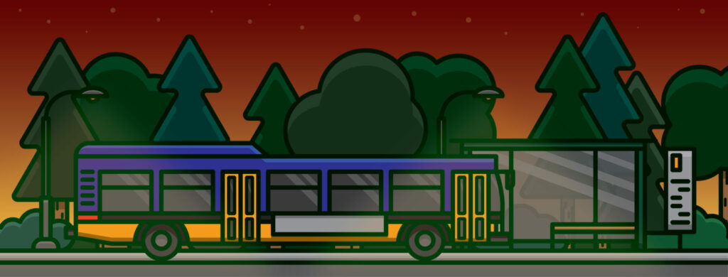 A purple and yellow bus and bus stop at dusk beside a forest