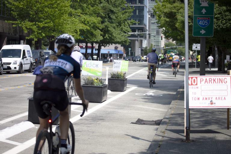 Someone biking down the new bike lane in Bellevue during it's opening