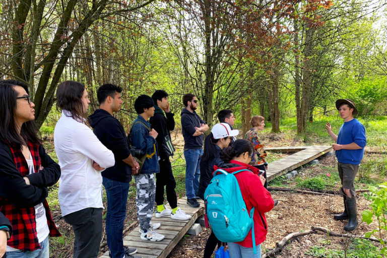A walking tour of 21 acres with a group of students during a sustainability field trip.