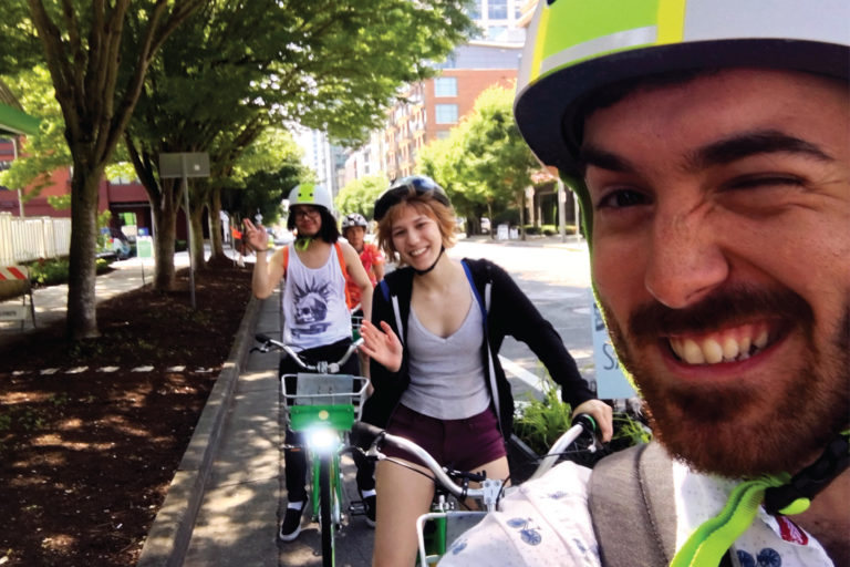 Members of the sustainability team bike riding together.