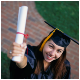female student raising her diploma up to the sky