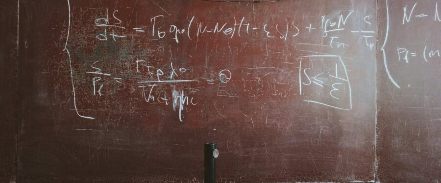 photo of math problems on an old board