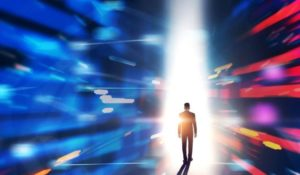 an individual in a suit walks into a beam of light, seemingly stepping through two walls, in an image that has the feel of a science fiction film