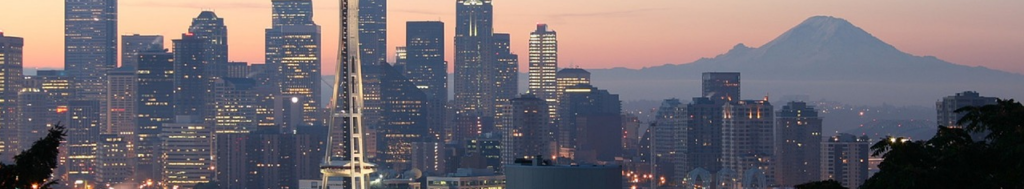 Image of downtown Seattle and Mount Rainier at sunset to indicate community