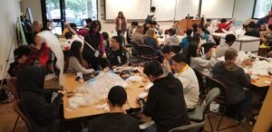 Group of students and faculty working with plastic