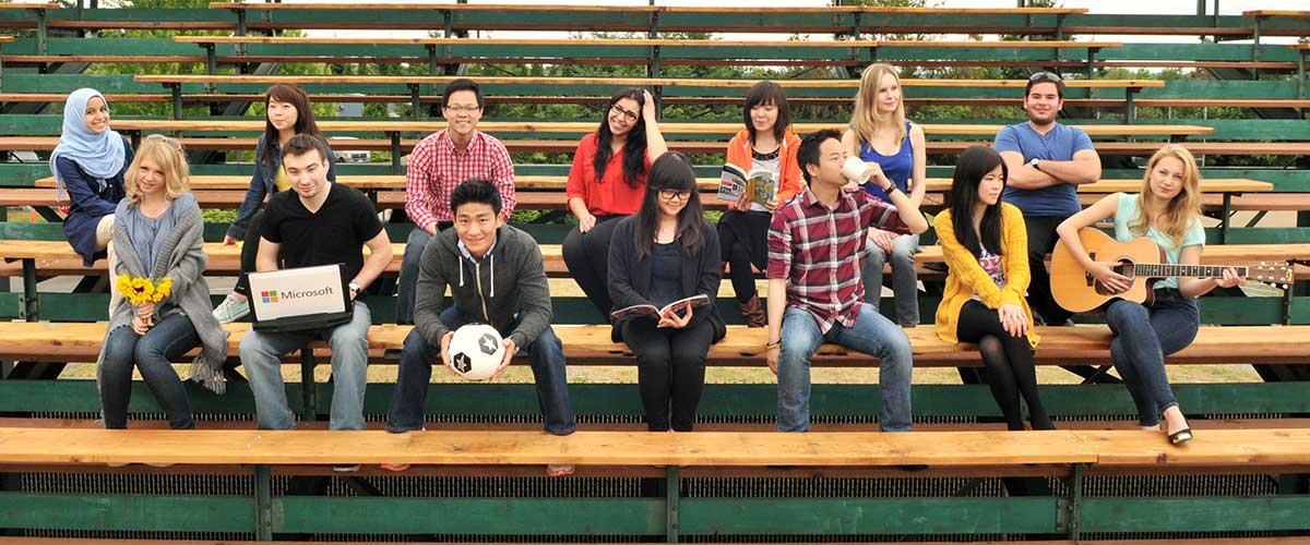 Bellevue College students sitting on bleachers