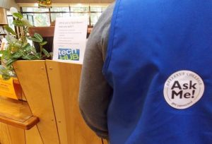 TechRovers with a blue jacket and AskMe logo
