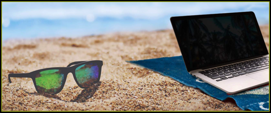 Sunglasses and laptop on relaxing beach