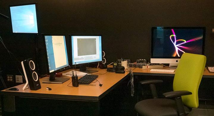 The Studio Q setup with three monitors and light-board