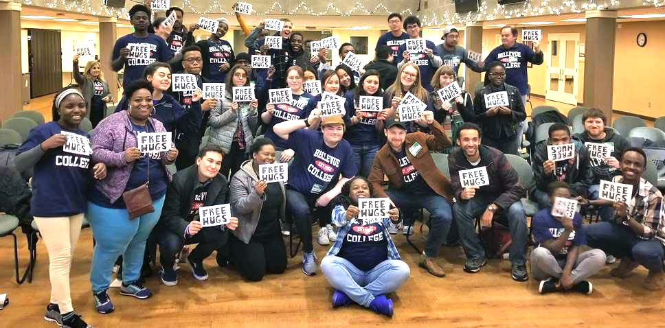 """Students holding signs for """"Free Hugs"""" at Leadership Retreat"""