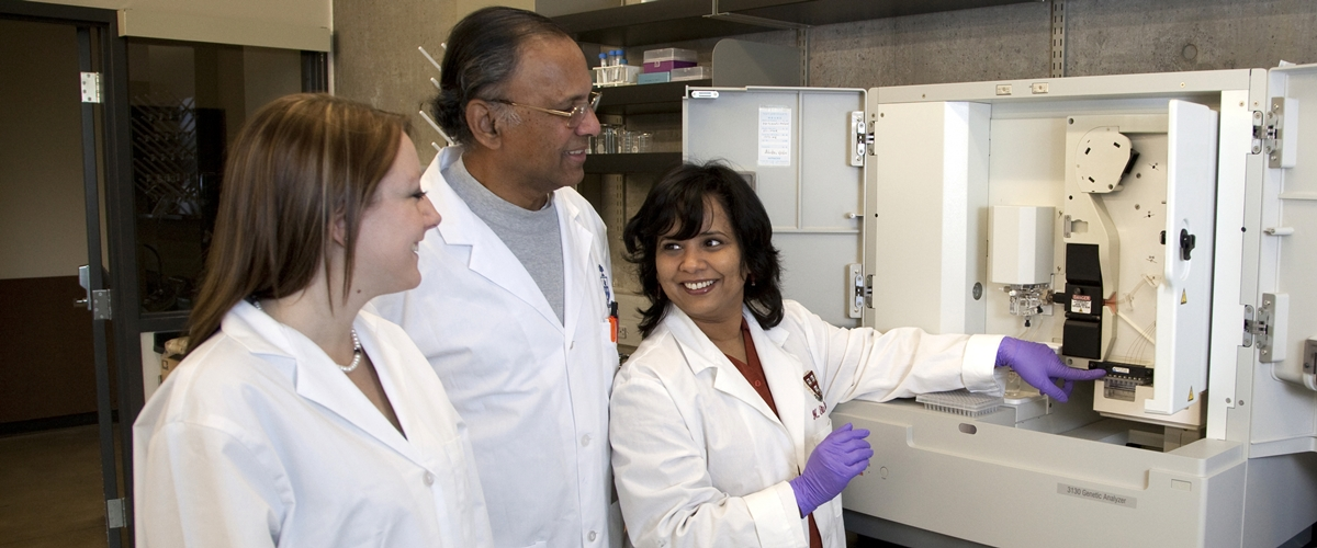 Dr. Rita Bangera (right) works with two students in the science lab