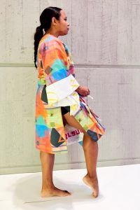 Person wearing colorful garment