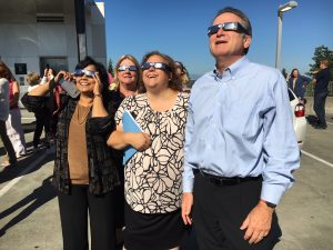 Dr. Weber, faculty & staff observing the eclipse