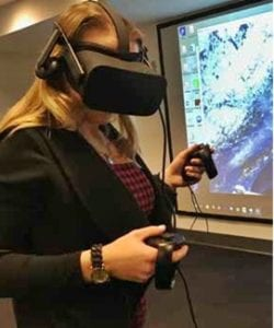 A person wearing virtual reality goggles