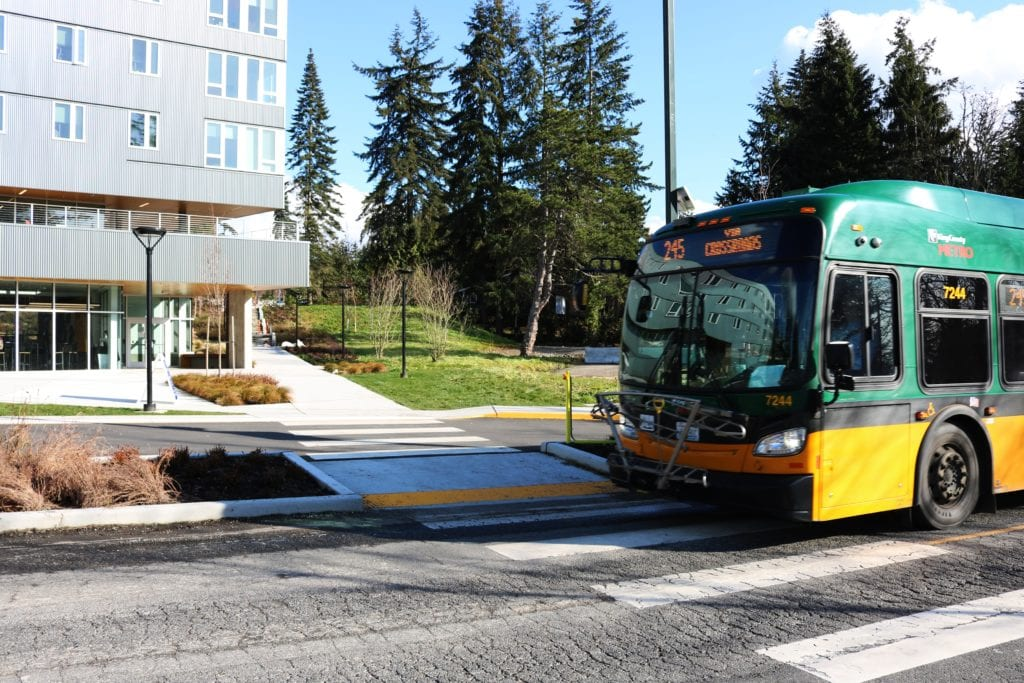 A bus in front of the residence hall