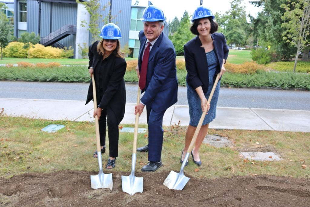 3 people digging with shovels