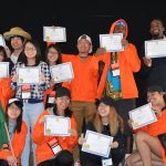Team holding up their certificates at Camp Casey