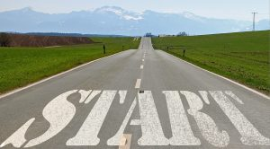 The word Start written on a road leading off into the distance