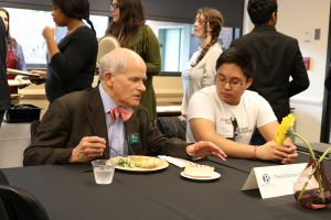 Justice Charles K. Wiggins with a student at a lucheon