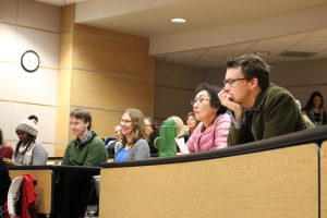 Community members listen closely at the open forum.