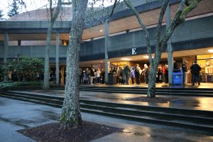 A long line of people waiting to get into the Carlson Theater.