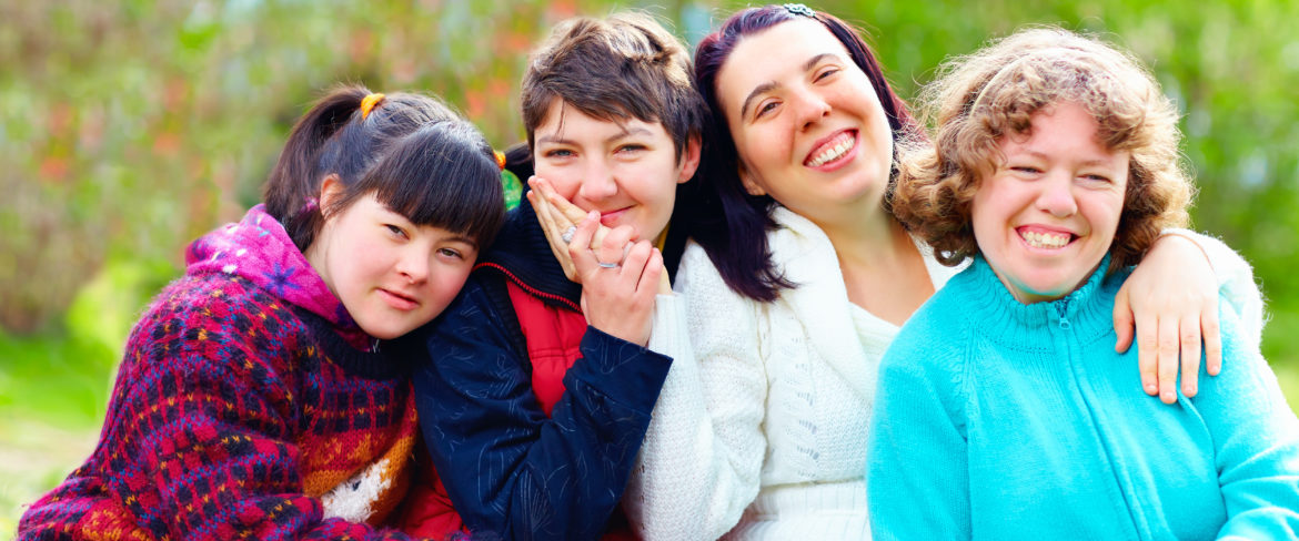 portrait of four young ladies in a park