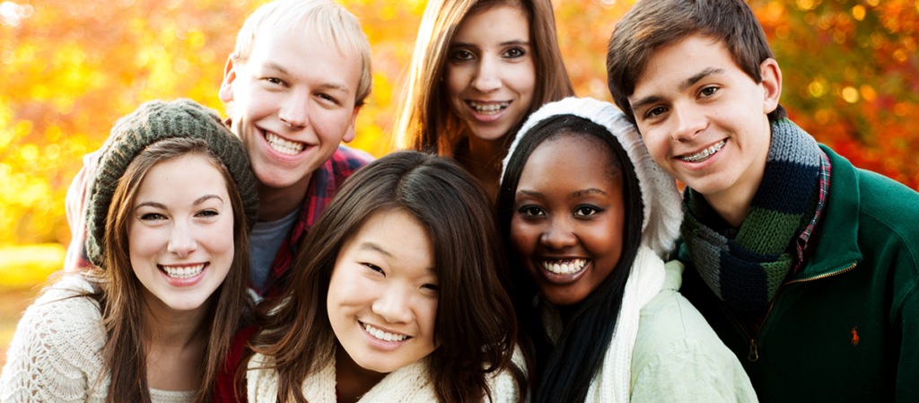 group of teenage friends in a park in autumn