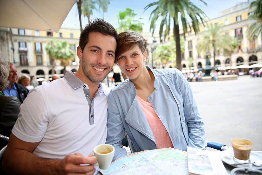 Man and woman at cafe in Europe