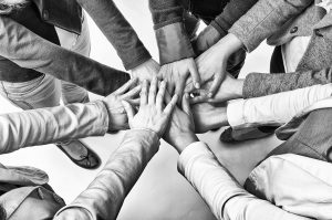 Hands joining together showing teamwork