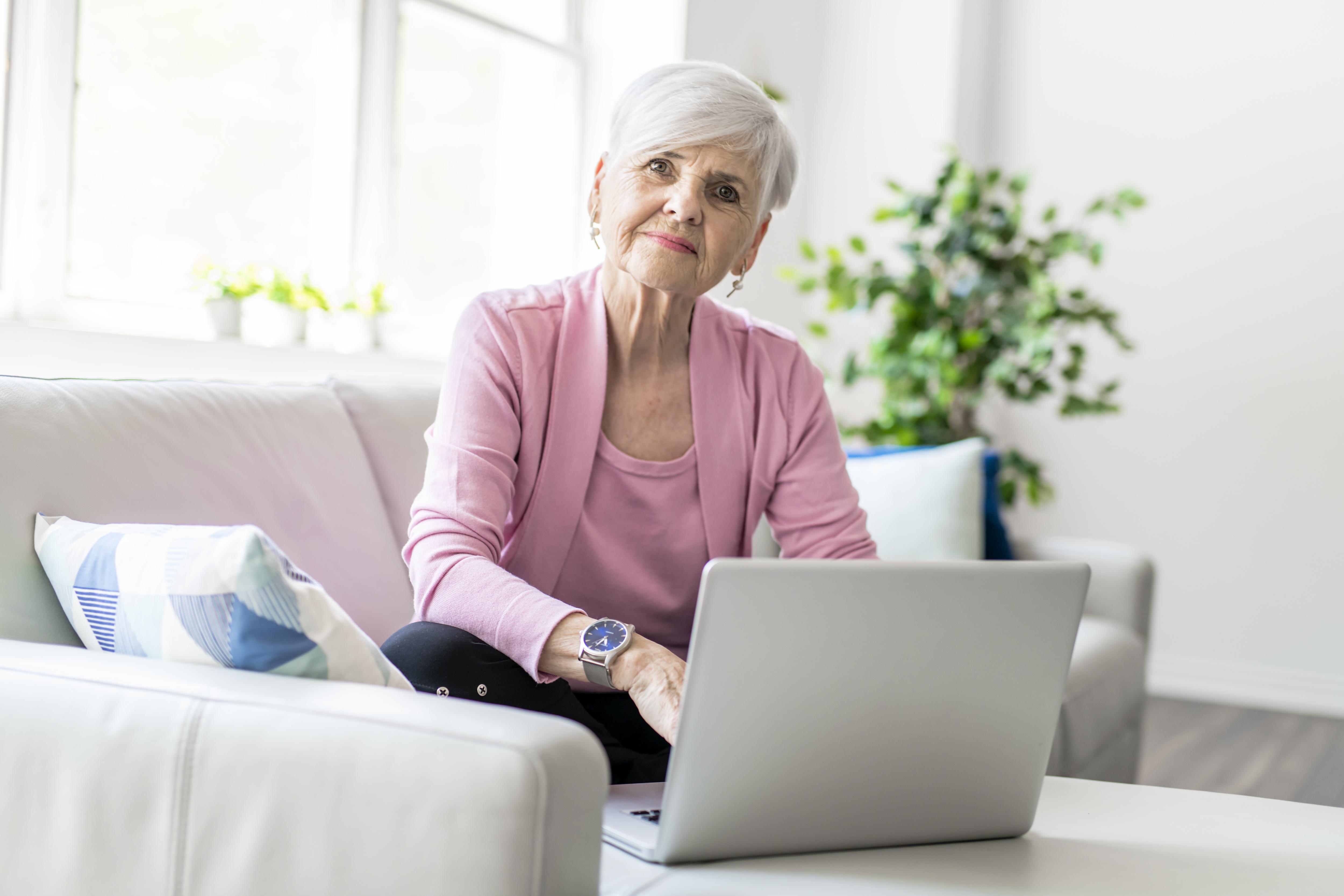 Retired senior woman learning online