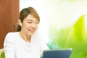 woman learning language online