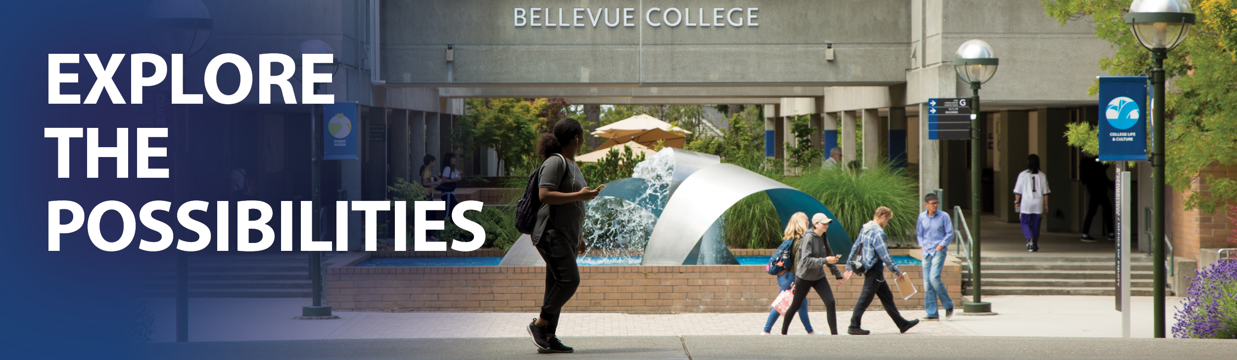 Explore the Possibilities. Black student wearing backpack walking in front of Bellevue College fountain, with other students walking in the background