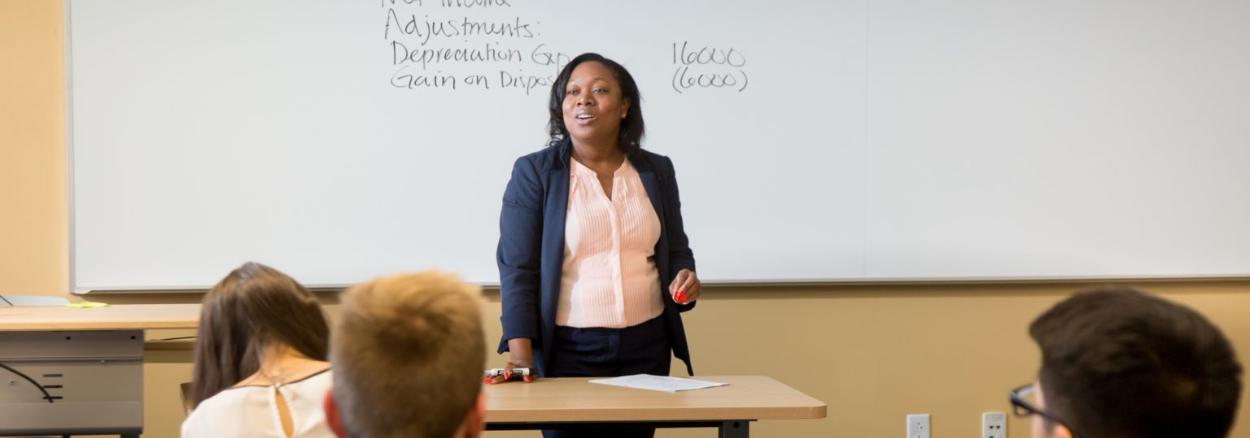 Bellevue College black faculty member Sheila Lozan teaching in front of class.