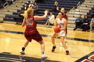 A BC player with the ball faces a defender