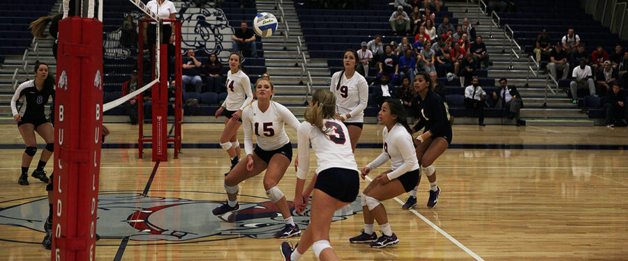 Bellevue College volleyball players get set to return the ball against Edmonds